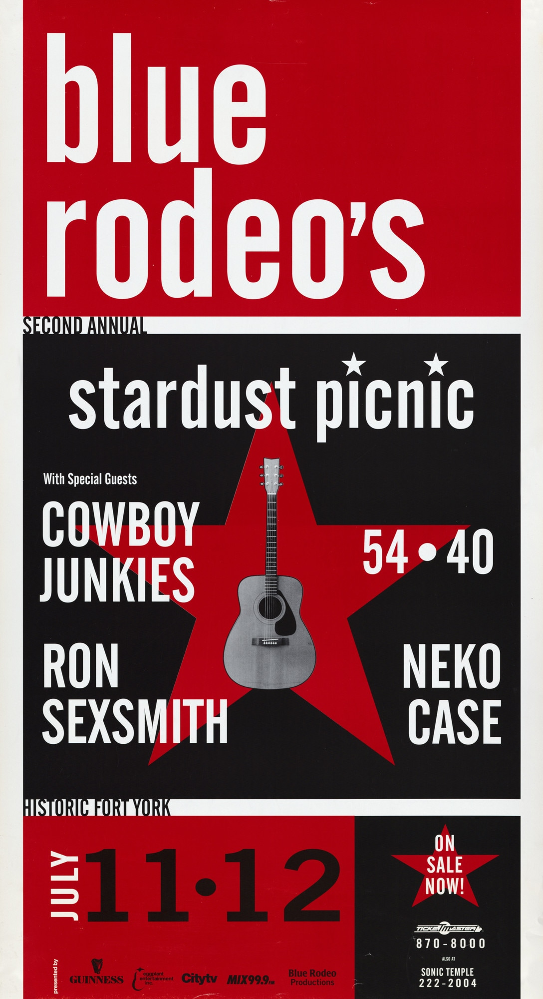"Poster split into three horizontal panels featuring three colours (red, white and black). The top panel reads ""blue rodeo's / Second Annual"". The middle panel reads ""stardust picnic""; on the left side, ""With Special Guests / Cowboy Junkies / Ron Sexsmith""; on the right side ""54 - 40 / Neko Case""; in the center of this panel is a guitar and a star. Finally, on the bottom panel reads ""historic Fort York / July 11-12,"" to the left ""On Sale now!"" below are logos of sponsors and phone numbers for Ticketmaster and Sonic Temple."