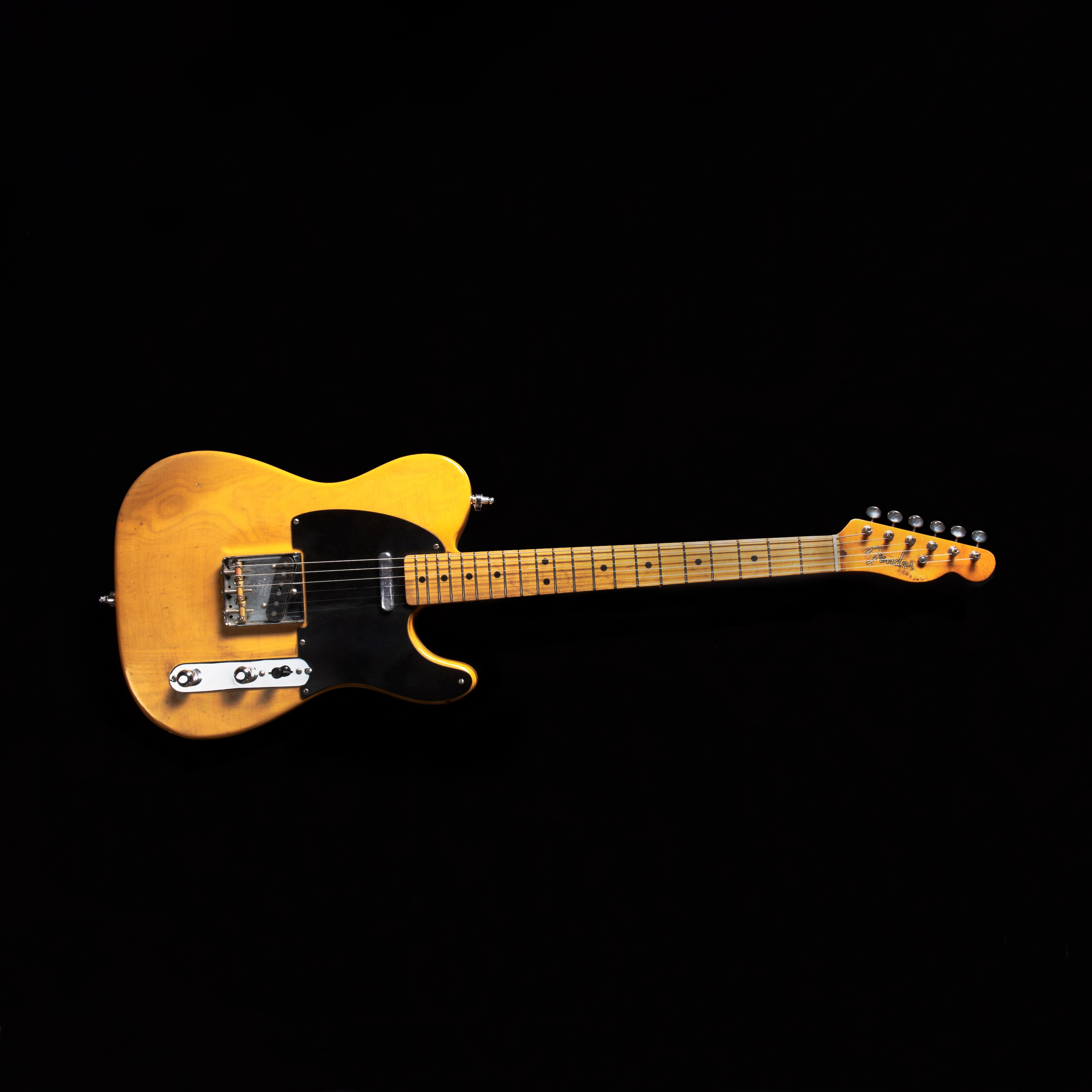 A colour photograph of Lorraine Segato's 1983 re-issued Telecaster fender guitar.