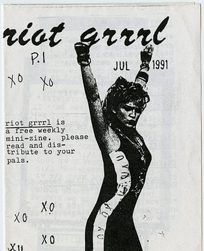 A black and white zine cover with the words riot grrrl written in cursive. Dated July 1991