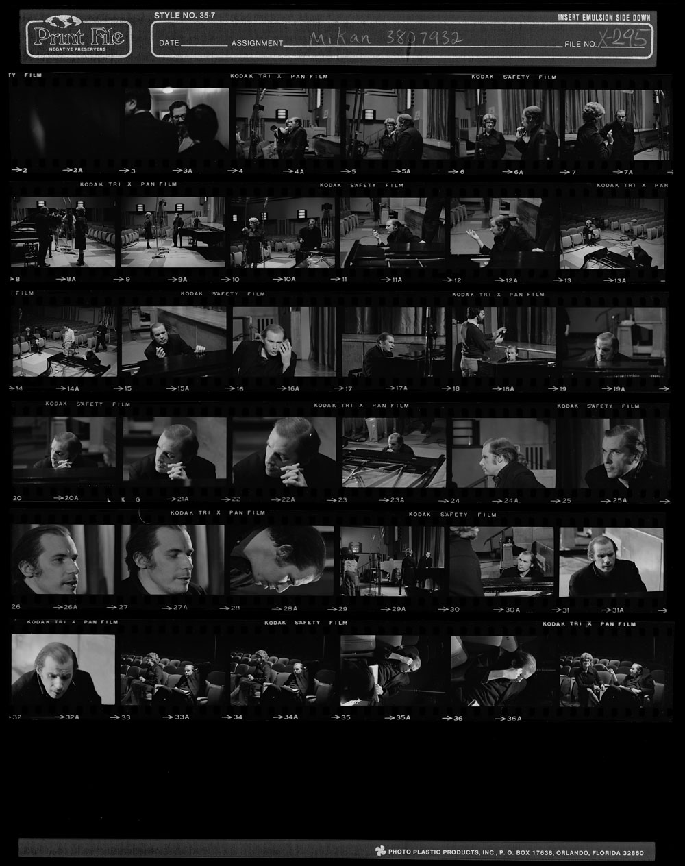 A series of shots from a filming showing a man at a piano in an auditorium.